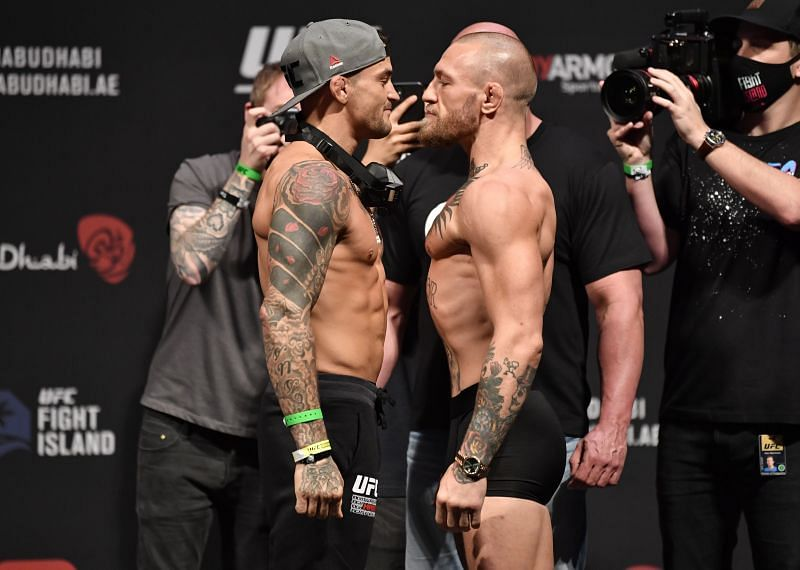 Dustin Poirier (Left) and Conor McGregor (Right) during UFC 257 weigh-in face-off