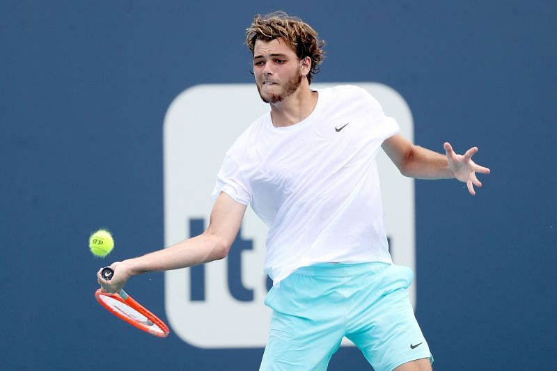 Taylor Fritz hits a forehand