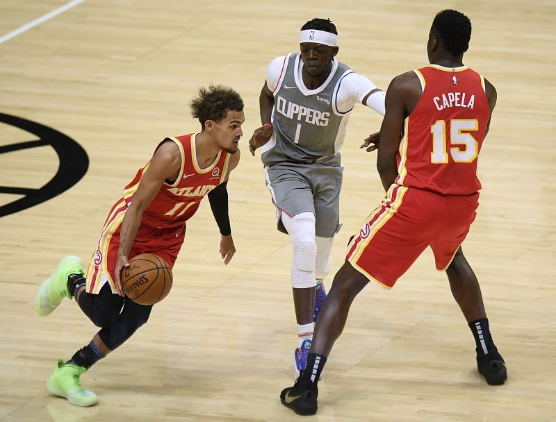 Trae Young #11 of the Atlanta Hawks uses Clint Capela #15 as for a screen on Reggie Jackson #1 of the LA Clippers