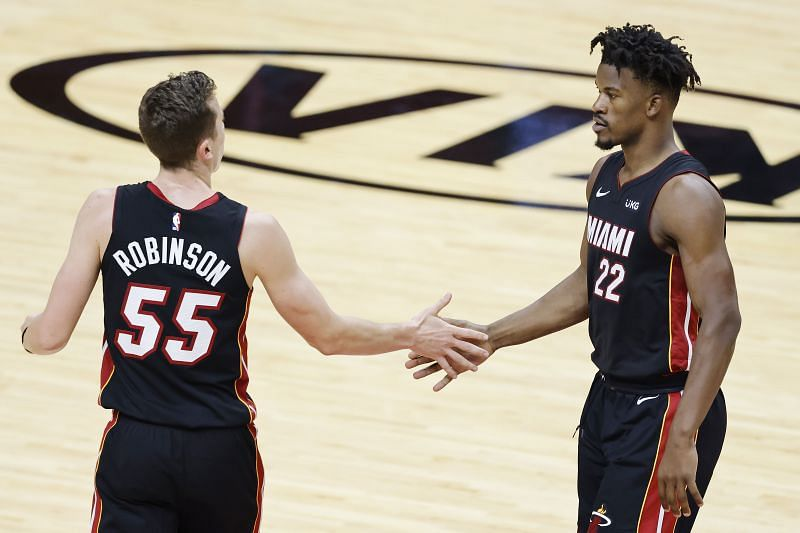Miami Heat teammates Jimmy Butler (right) and Duncan Robinson