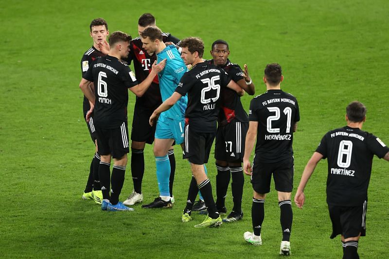 Bayern players celebrate the win at full-time.