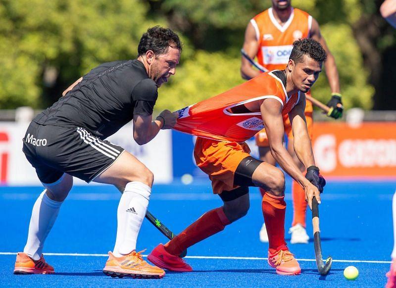 Shilanand Lakra in action against Argentina. (Source: HI)