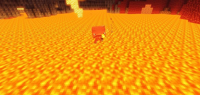 Shown: A Strider striding through a large lava pool (Image via Minecraft)