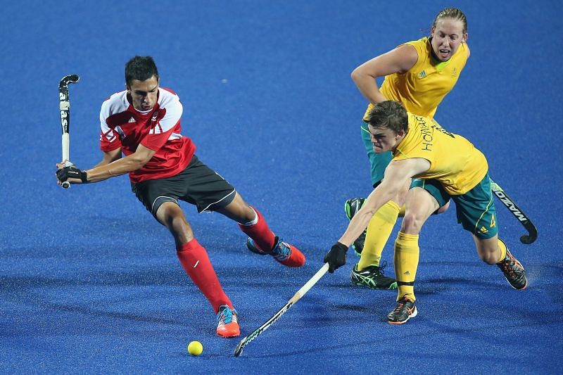 Australia and Canada (red) in action during a Hockey5s match at 2014 Summer Youth Olympic Games