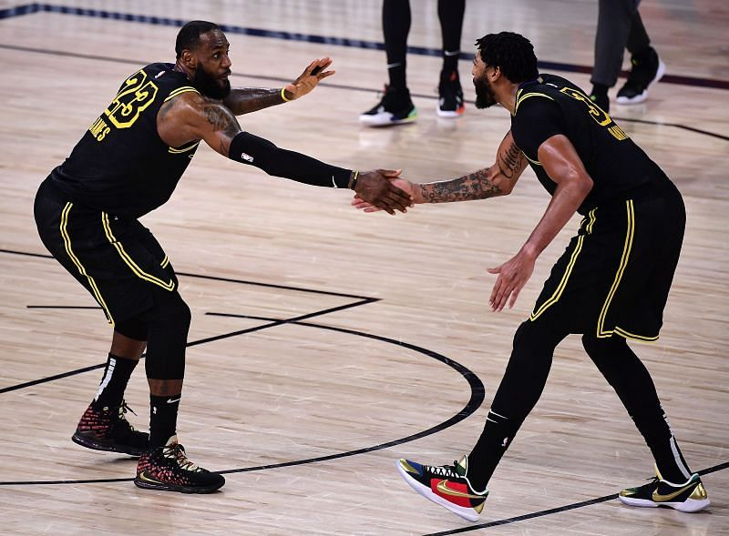 LeBron James #23 and Anthony Davis #3 react during the fourth quarter against the Houston Rockets