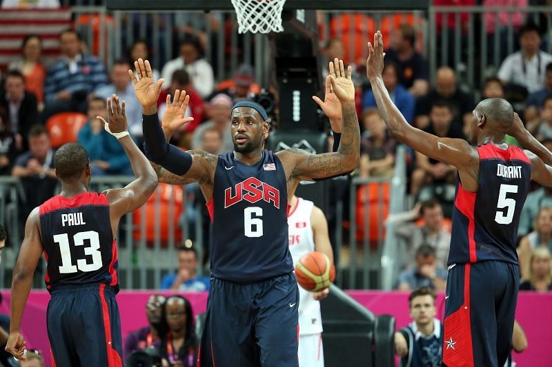 LeBron James (#6) of the United States high-fives his teammates Chris Paul (#13) and Kevin Durant (#5)