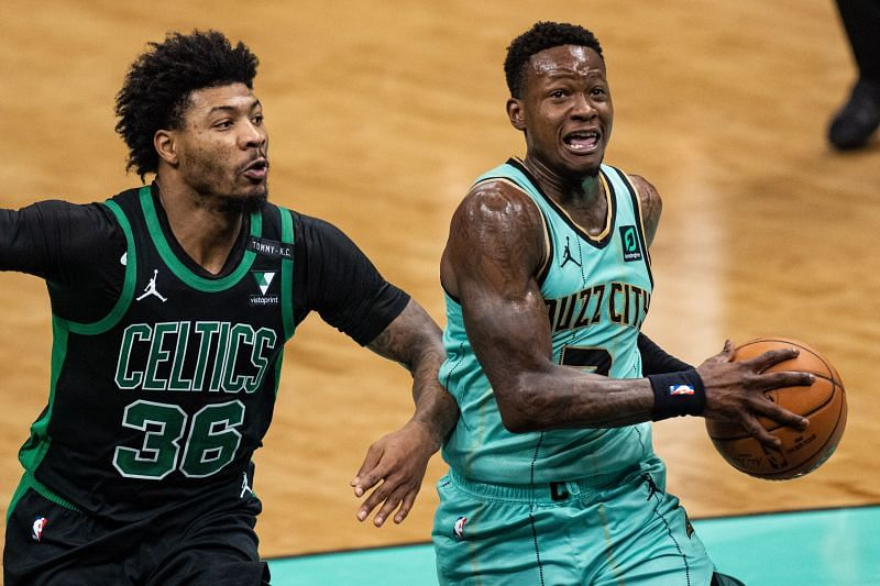 Terry Rozier (#3) of the Charlotte Hornets drives to the basket against Marcus Smart (#36) of the Boston Celtics