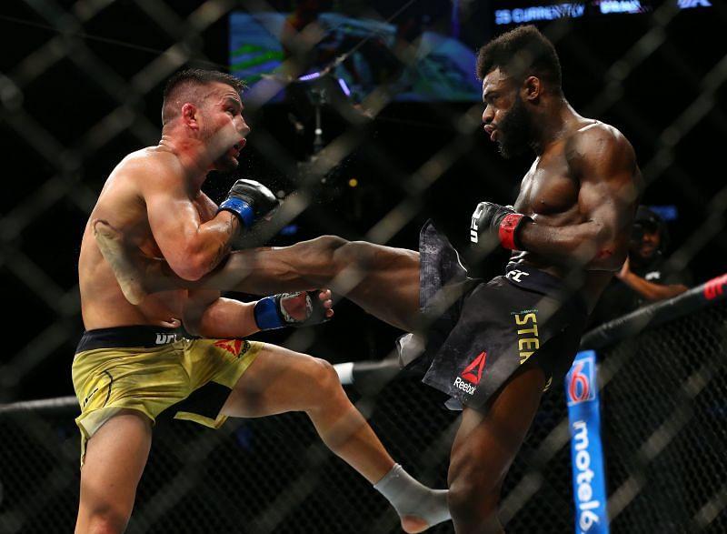 Aljamain Sterling (right) kicks Pedro Munhoz (left) UFC 238