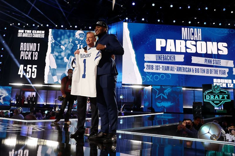 Penn State linebacker Micah Parsons poses on stage with NFL Commissioner Roger Goodell after the Dallas Cowboys selected Parsons with the 12th overall pick in NFL Draft on April 29, 2021.