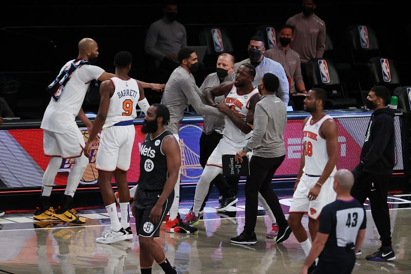 Julius Randle #30 is restrained by teammates after their 117-112 loss against the Brooklyn Nets