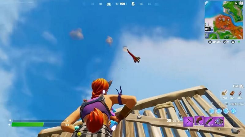 Raptor being shot into the air by the Spire pad (Image via YouTube, Top5Gaming)
