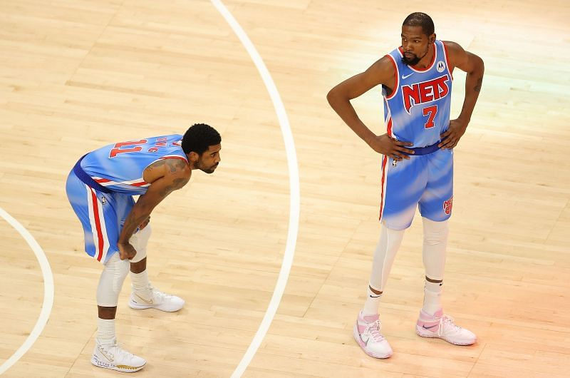 Kyrie Irving #11 and Kevin Durant #7 wait for the tip.
