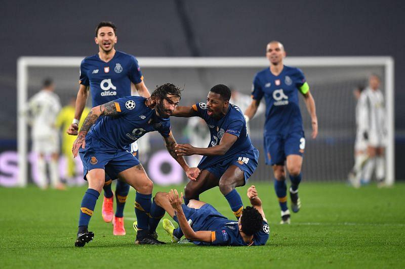 Sergio Oliveira (left) celebrates with Manafa and Diaz after scoring against Juventus