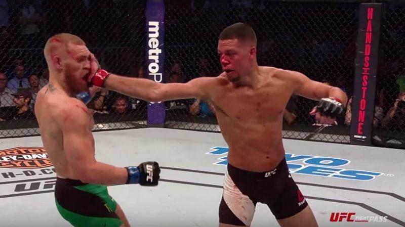 Nate Diaz slaps Conor McGregor.