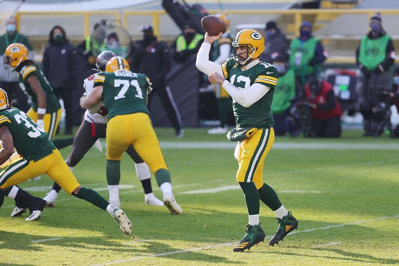 Green Bay Packers quarterback Aaron Rodgers looks to pass against the Tampa Bay Buccaneers on Jan. 24, 2021, in Green Bay, Wisconsin.