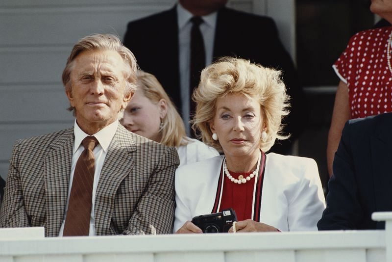 Kirk Douglas and Anne Douglas at a polo match in the UK in July 1987 (Image via Getty)