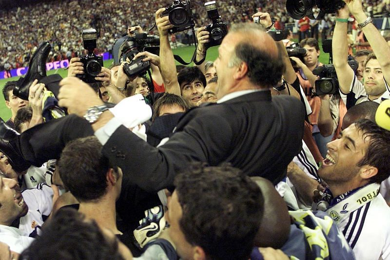 Real Madrid coach Vicente Del Bosque is lifted in the air by his players after clinching La Liga Championship in 2001
