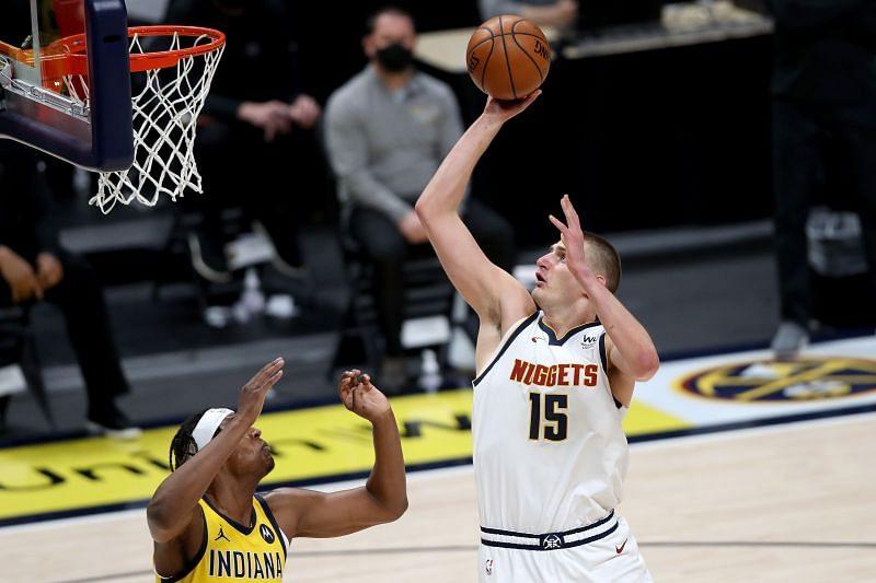 Nikola Jokic #15 of the Denver Nuggets puts up a shot.