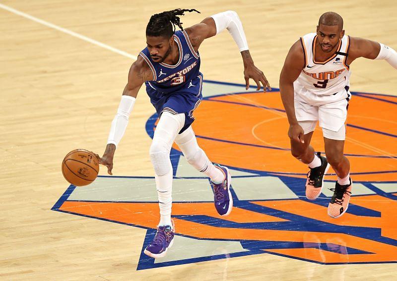 New York Knicks center Nerlens Noel fights for the ball