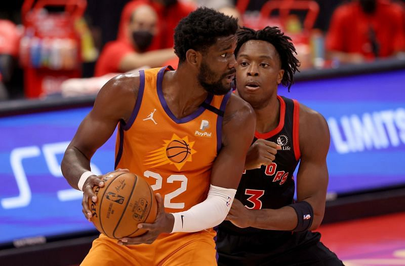 Deandre Ayton #22 is defended by Pascal Siakam #43.