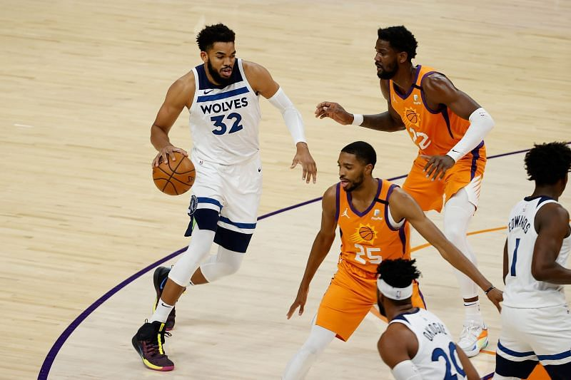Karl-Anthony Towns #32 of the Minnesota Timberwolves controls the ball.