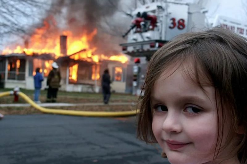 Zoe Roth watching a house burn down, which later came to be known as Disaster Girl meme (Image via Dave Roth)