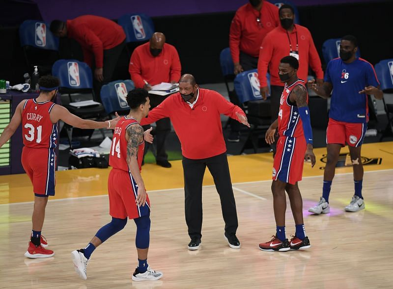 Head coach Doc Rivers of the Philadelphia 76ers celebrates with Seth Curry (#31), Danny Green (#14) and Paul Reed (#44).