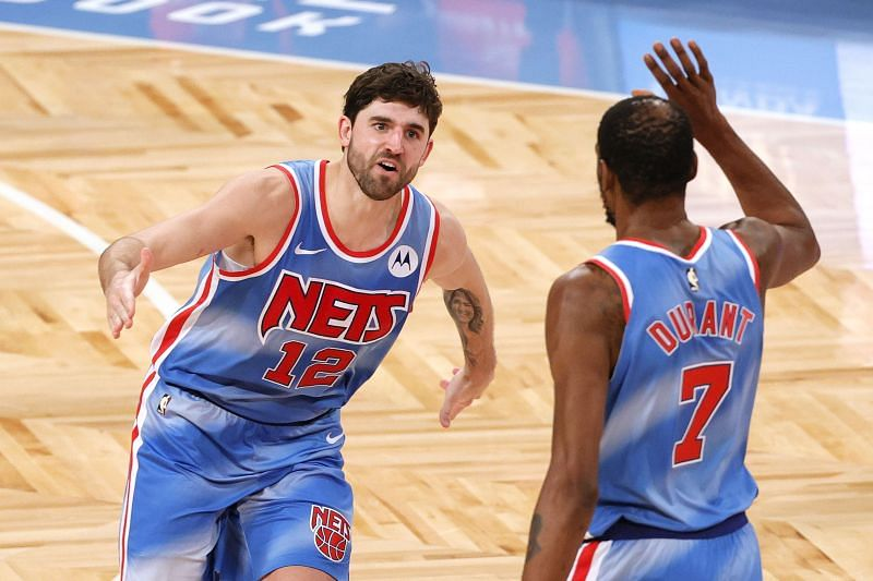 Joe Harris #12 reacts with Kevin Durant #7 of the Brooklyn Nets.