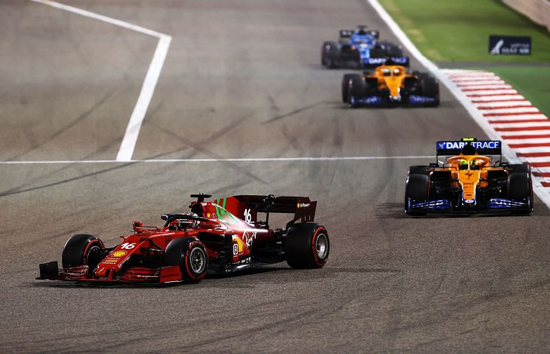Charles Leclerc of Scuderia Ferrari leads the Mclarens in Bahrain, 2021. Photo: Bryn Lennon/Getty Images.