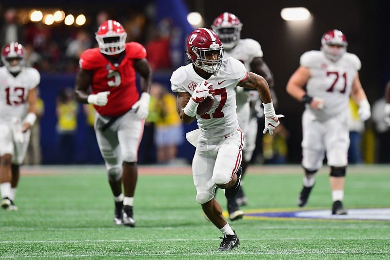 Alabama wide receiver Jaylen Waddle breaks away for a touchdown against the Georgia Bulldogs in a game from 2018.