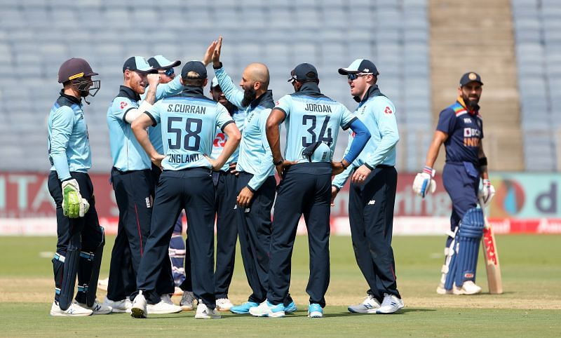 England cricket team celebrating a fall of a wicket.