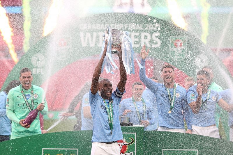 Manchester City lift the 2021 League Cup trophy