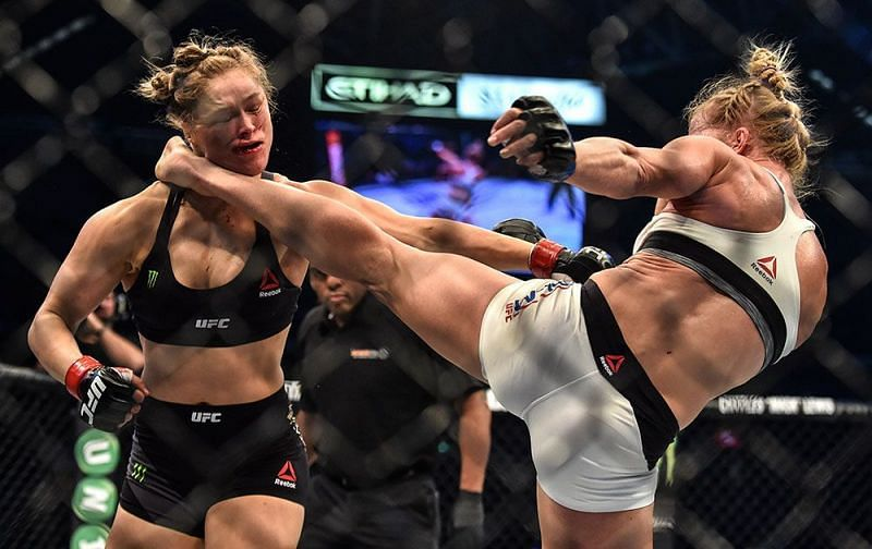 Holly Holm head kicks Ronda Rousey (Photo Credit: PAUL CROCK / AFP / Getty Images)