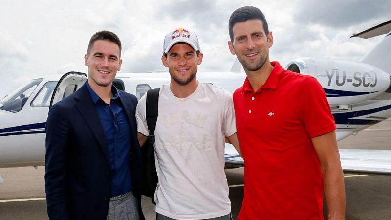 Djordje Djokovic poses with Dominic Thiem and Novak Djokovic