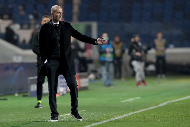 Real Madrid boss Zinedine Zidane watches on during a Champions League clash