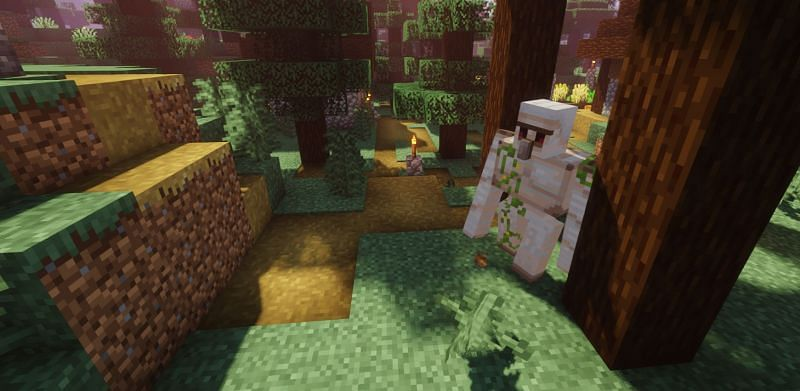 Shown: A Golem patrolling the outskirts of the village (Image via Minecraft)