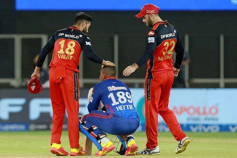 Shimron Hetmyer is consoled by Virat Kohli and Glenn Maxwell. Pic: IPLT20.COM