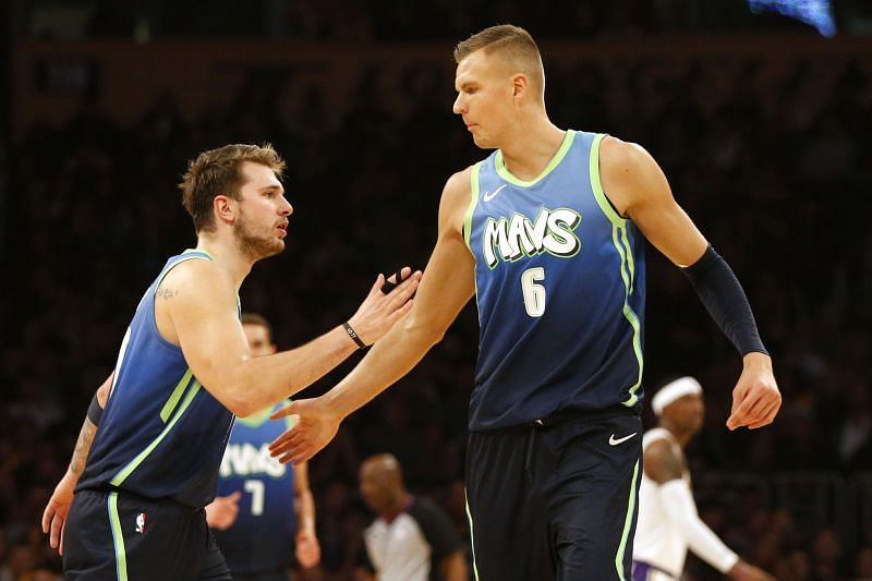Luka Doncic #77 and Kristaps Porzingis #6 high-five during a game