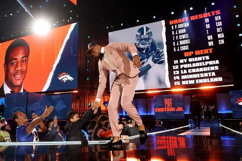 2Alabama cornerback Patrick Surtain II walks onto the NFL Draft stage after being selected ninth overall by the Denver Broncos on April 29, 2021.