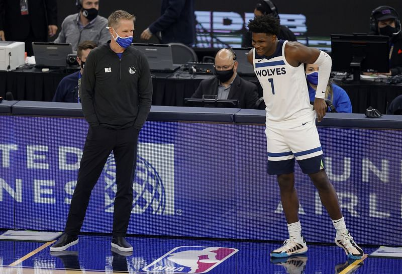 Steve Kerr speaks to Anthony Edwards #1 when he checks in for their game