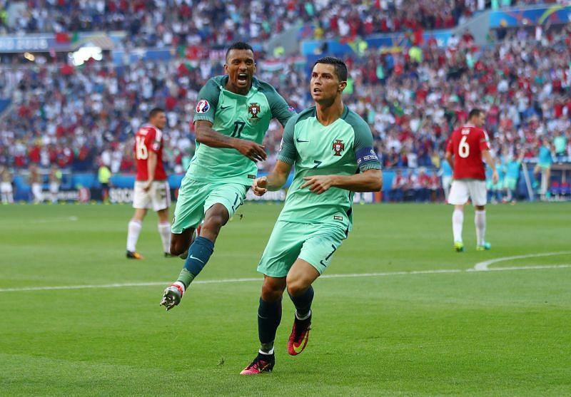 Cristiano Ronaldo and Nani celebrate a goal for Portugal