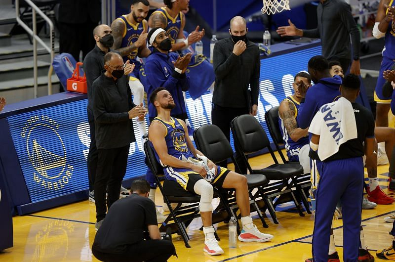 Stephen Curry #30 of the Golden State Warriors is surrounded by teammates applauding him after he made a basket to pass Wilt Chamberlain as the Golden State Warriors all-time leading scorer.