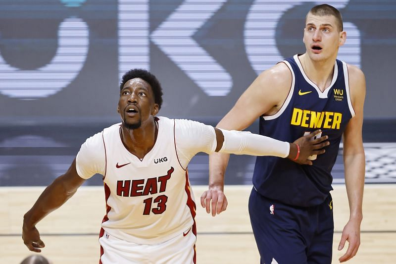 Bam Adebayo #13 of the Miami Heat and Nikola Jokic #15 of the Denver Nuggets