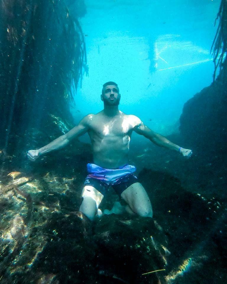 Jiri Prochazka poses at the bottom of a lake