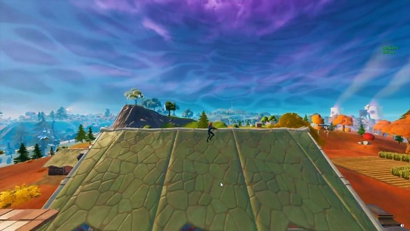 Player on top of a building before the arrow makes contact (Image via Reddit, u/twstdwrstr)