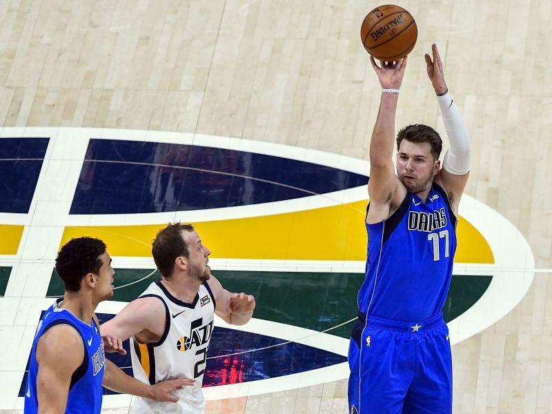 Luka Doncic (#77) of the Dallas Mavericks shoots over Joe Ingles (#2) of the Utah Jazz