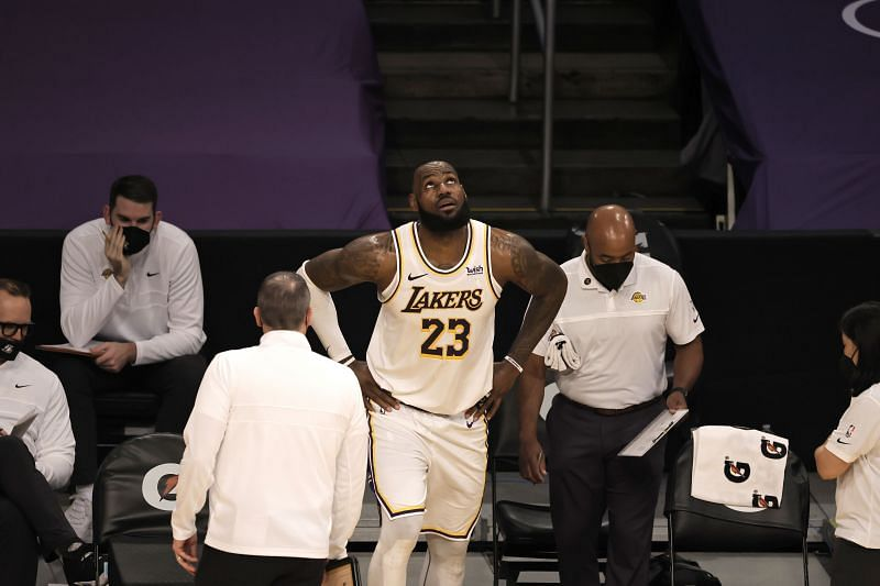 LA Lakers leader LeBron James watches on after getting injured against Atlanta