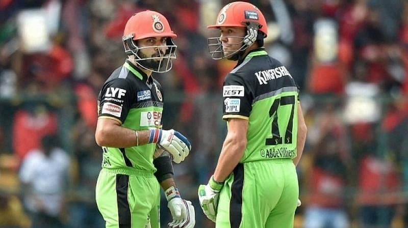 Virat Kohli (left) and AB De Villiers featured in a record partnership.