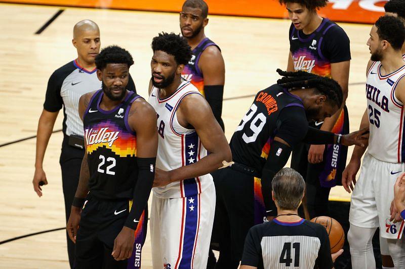 Deandre Ayton #22 of the Phoenix Suns and Joel Embiid #21 of the Philadelphia 76ers