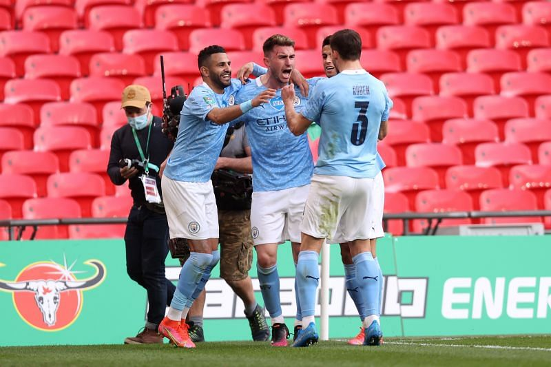 Laporte (Centre) celebrating the winner for Manchester City
